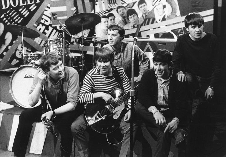 English rock group The Animals, posed on the set of the TV show 'Ready Steady Go!' circa 1963. They are bassist Chas Chandler, drummer John Steel, guitarist Hilton Valentine, singer Eric Burdon and keyboard player Alan Price. (Photo by Val Wilmer/Redferns/Getty Images)