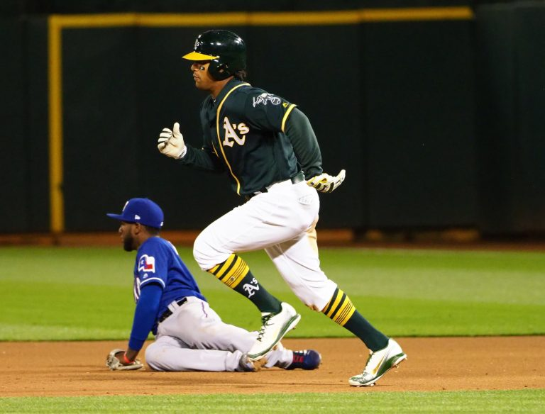 A's and Rangers swap Khris Davis and Elvis Andrus in buy-low deal