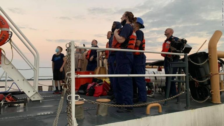 Four children and two adults were rescued from a sinking boat off Georgia coast