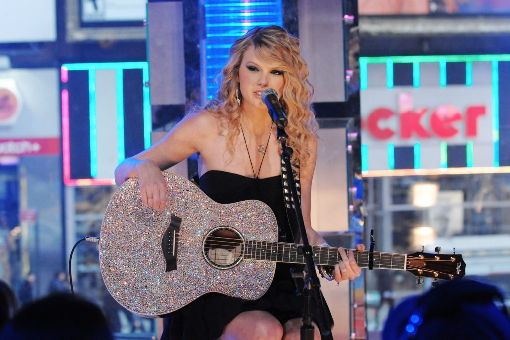 Singer Taylor Swift performs during an appearance on MTV's Total Request Live, Wednesday, Feb.27, 2008 in New York. (AP Photo/Evan Agostini)