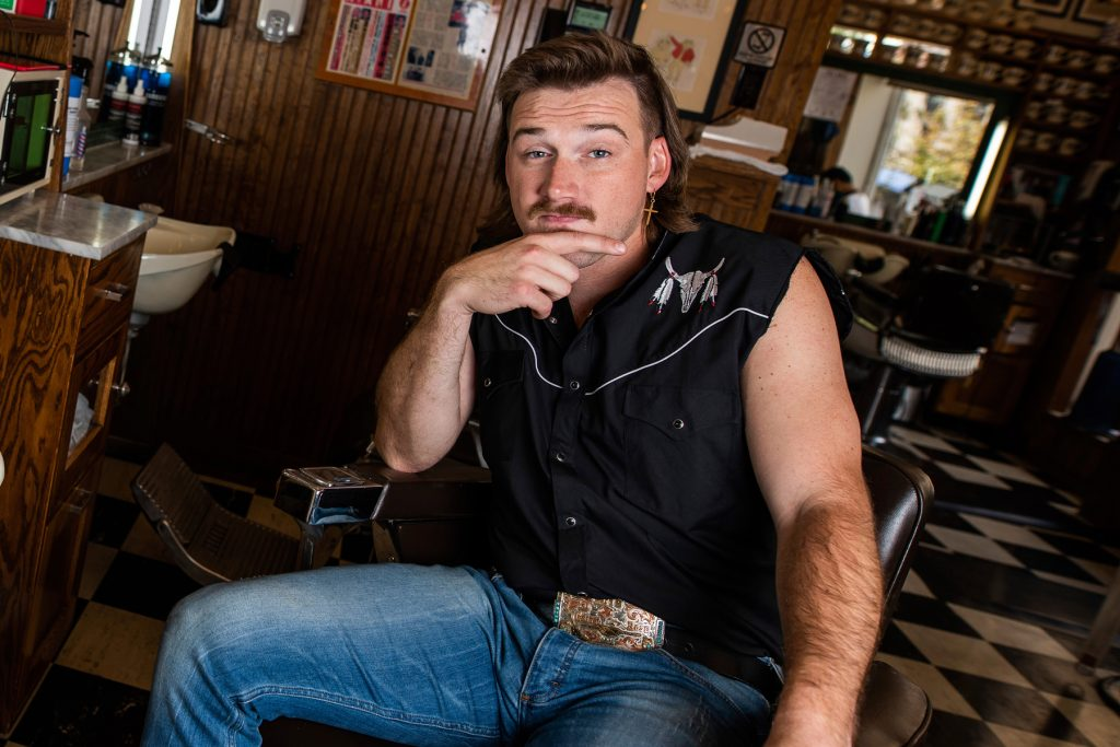 "Country singer Morgan Wallen poses for a portrait after getting a mullet at Paul Mole Barber Shop on Tuesday, Aug. 27, 2019, in New York. Wallen, who has turned heads with his likable hit song ""Whiskey Glasses,"" said he decided to try a mullet after seeing old photos of his dad proudly rocking the hairstyle. (Photo by Charles Sykes/Invision/AP)"