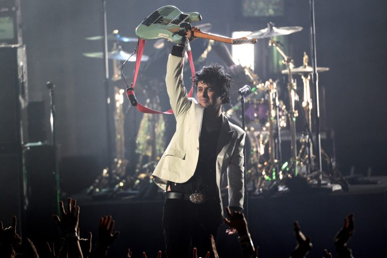 Billie Joe Armstrong, of Green Day, performs a medley at the American Music Awards on Sunday, Nov. 24, 2019, at the Microsoft Theater in Los Angeles. (Photo by Chris Pizzello/Invision/AP)