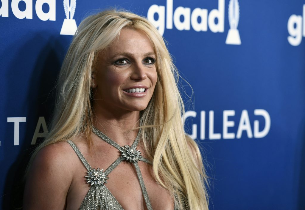 """FILE - This April 12, 2018 file photo shows Britney Spears at the 29th annual GLAAD Media Awards in Beverly Hills, Calif. Though Black Out Tuesday was originally organized by the music community, the social media world went dark on Tuesday in support of the Black Lives Matter movement and the many killings of black people around the world that has caused outrage and protests. """"I won't be posting on social media and I ask you all to do the same,"""" Britney Spears tweeted. """"We should use the time away from our devices to focus on what we can do to make the world a better place …. for ALL of us !!!!!"""" (Photo by Chris Pizzello/Invision/AP, File)"""