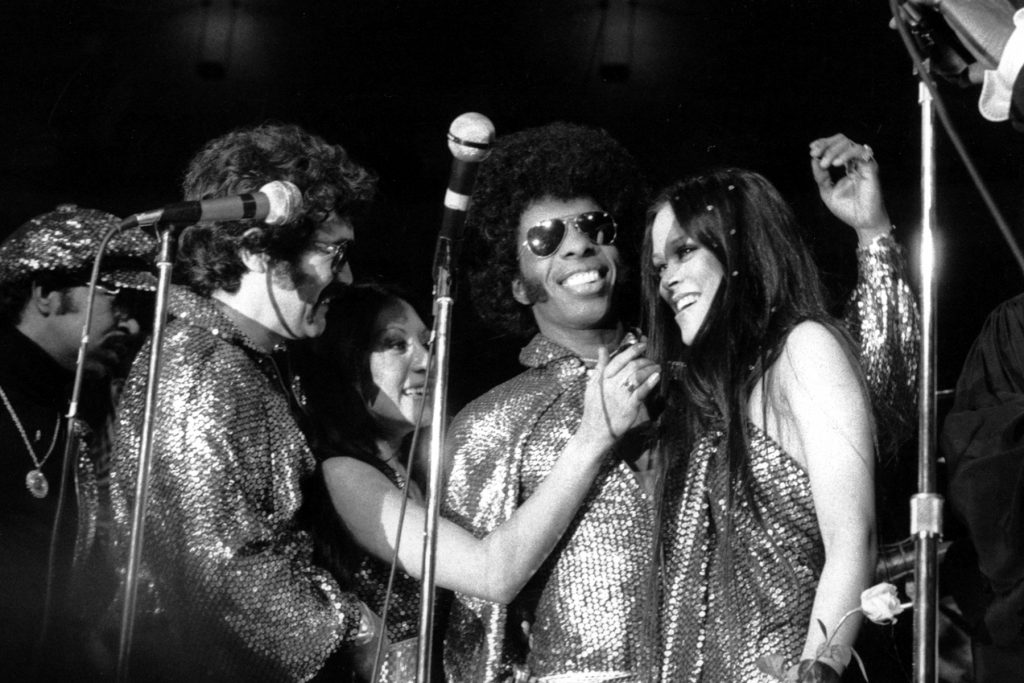 """Sylvester """"Sly"""" Stewart and his bride Kathy Silva are congratulated by well-wishers during their wedding ceremony at a rock concert in New York's Madison Square Garden on June 6, 1974.  """"Sly"""" and his group """"Sly and the Family Stone"""" performed at the concert.  (AP Photo)"""
