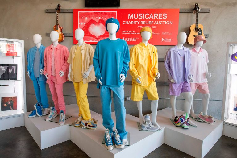 "Ensembles worn by K-pop band BTS on their ""Dynamite"" music video are displayed at the MusiCares Charity Relief auction Press Preview at Julien's Auctions, January 26, 2021, in Beverly Hills, California. - The Musicares Charity Relief Auction will be held January 31, 2021. (Photo by VALERIE MACON / AFP) (Photo by VALERIE MACON/AFP via Getty Images)"