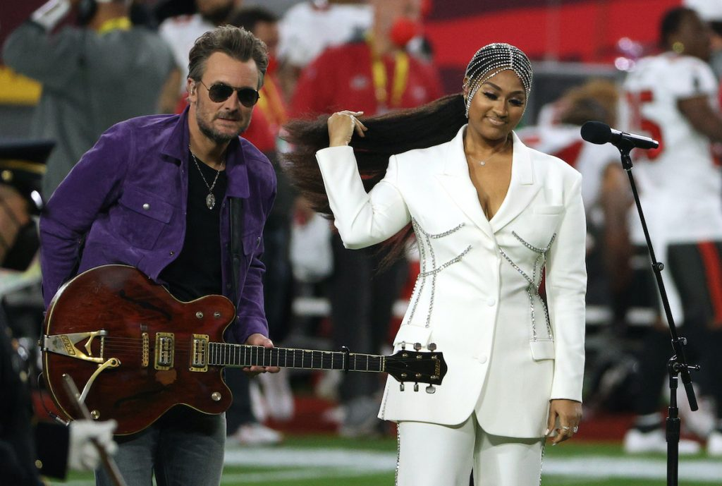 TAMPA, FLORIDA - FEBRUARY 07: Jazmine Sullivan and Eric Church perform the national anthem before Super Bowl LV between the Tampa Bay Buccaneers and the Kansas City Chiefs at Raymond James Stadium on February 07, 2021 in Tampa, Florida. (Photo by Patrick Smith/Getty Images)