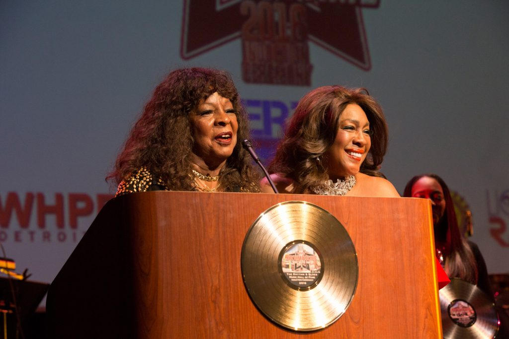 DETROIT, MI - AUGUST 21:  Singer Martha Reeves presents Singer/Inductee Mary WIlson with award at the 4th Annual Rhythm & Blues Music Hall Of Fame Induction Ceremony in Metro Detroit on August 21, 2016 in Detroit, Michigan.  (Photo by Monica Morgan/Getty Images)