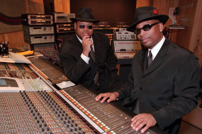"Grammy-winning producers Jimmy ""Jam"" Harris, left, and Terry Lewis, right, pose in one of their recording studios at Flyte Tyme in Edina, Minn., Tuesday, Oct. 21, 1997. For 15 years, Jam and Lewis have been writing and producing hits for such stars as Janet Jackson, Boyz II Men, Mary J. Blige, Herb Alpert, Jon Secada, New Edition and Johnny Gill.  (AP Photo/Ann Heisenfelt)"