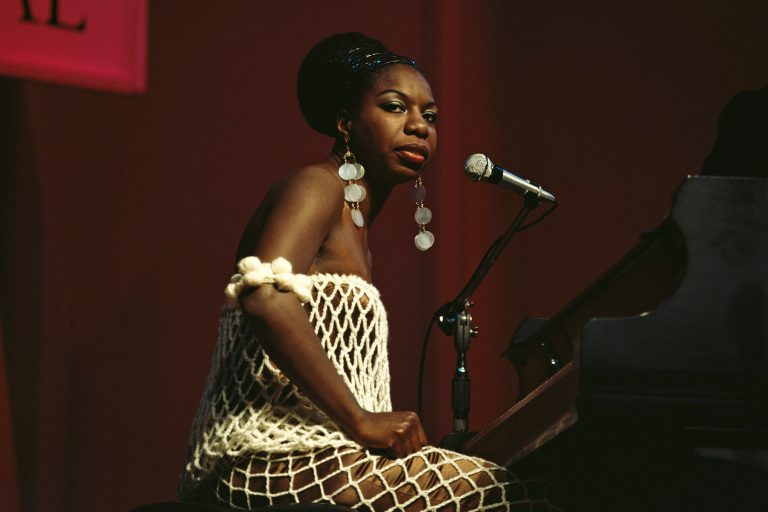 American singer, songwriter, pianist and civil rights activist Nina Simone (1933-2003) performs live on stage at Newport Jazz Festival in Newport, Rhode Island, United States on 4th July 1968. David Redfern Premium Collection. (Photo by David Redfern/Redferns)