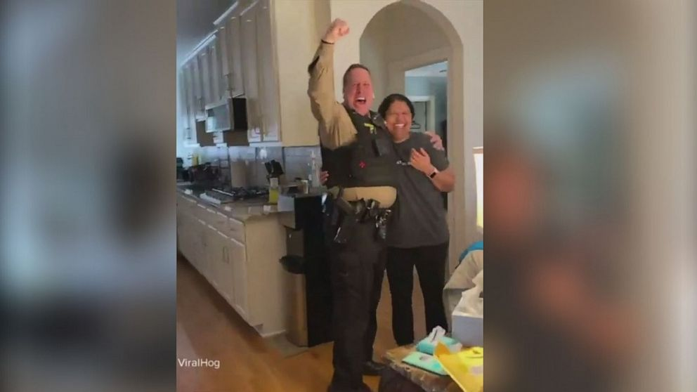 Nurse who battled cancer through school surprises dad with news she's cancer-free