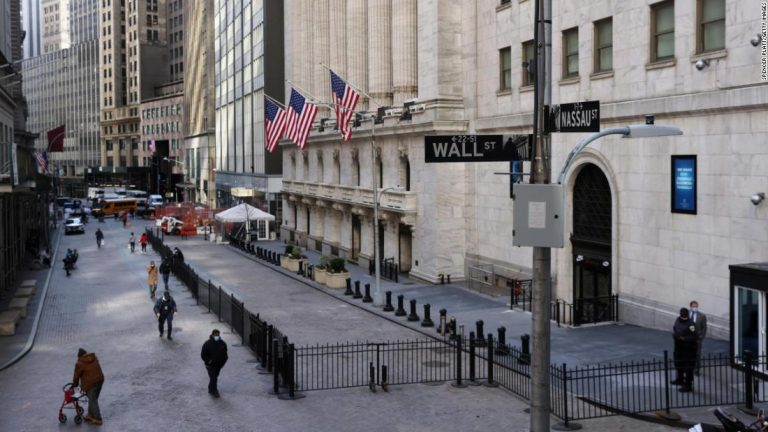 People walk by the New York Stock Exchange (NYSE) on February 25, 2021 in New York City.