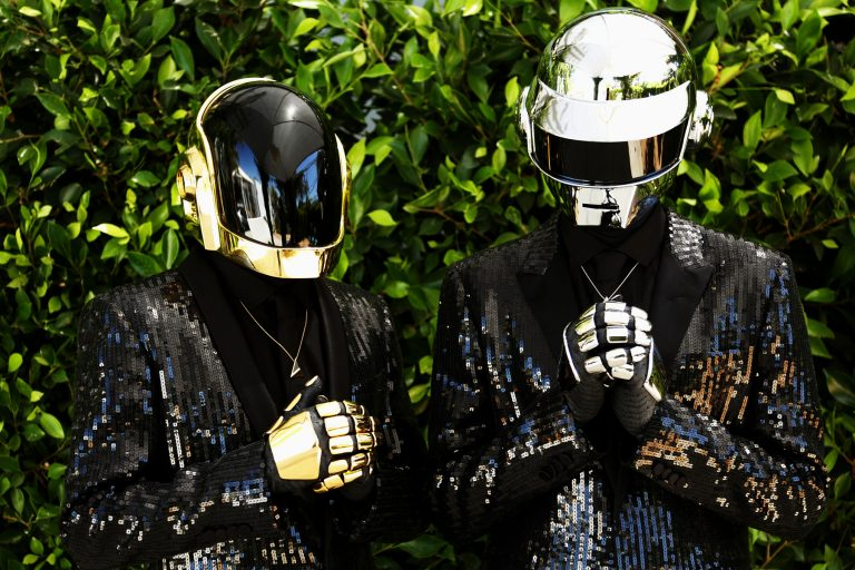 Thomas Bangalter, right, and Guy-Manuel de Homem-Christo, from the group Daft Punk pose for a portrait on Wednesday, April 17, 2013 in Los Angeles. (Photo by Matt Sayles/Invision/AP)