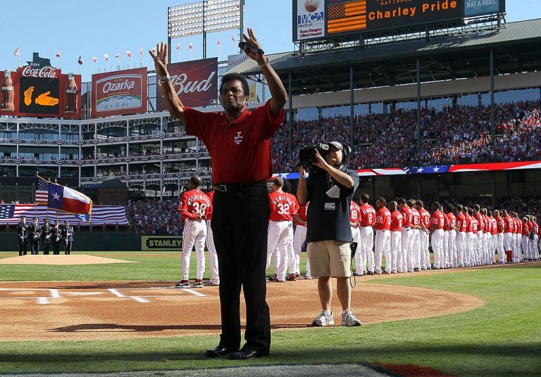 ARLINGTON, TX - OCTOBER 9:  Country singer Charley Pride waves after singing the national anthem before game three of the ALDSthe Tampa Bay Rays and the Texas Rangers at Rangers Ballpark in Arlington on October 9, 2010 in Arlington, Texas.  (Photo by Stephen Dunn/Getty Images)