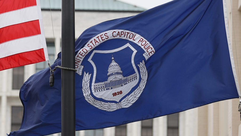 U.S. Arrests 2 Men, Saying They Sprayed Police Officers At Capitol : NPR