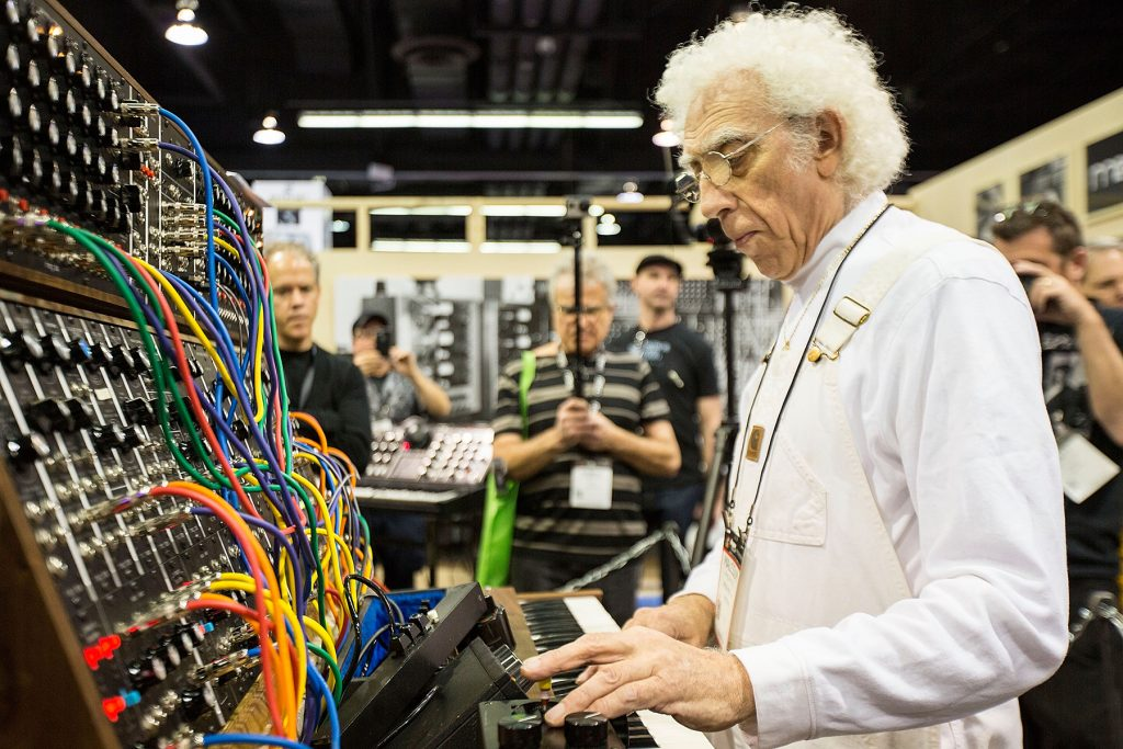 ANAHEIM, CA - JANUARY 25:  Producer/musician Malcolm Cecil demonstrates a Moog synthesizer at The NAMM Show on January 25, 2015 in Anaheim, California.  (Photo by Daniel Knighton/WireImage)