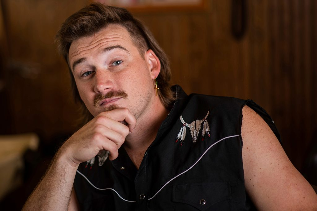 """Country singer Morgan Wallen poses for a portrait after getting a mullet at Paul Mole Barber Shop on Tuesday, Aug. 27, 2019, in New York. Wallen, who has turned heads with his likable hit song """"Whiskey Glasses,"""" said he decided to try a mullet after seeing old photos of his dad proudly rocking the hairstyle. (Photo by Charles Sykes/Invision/AP)"""