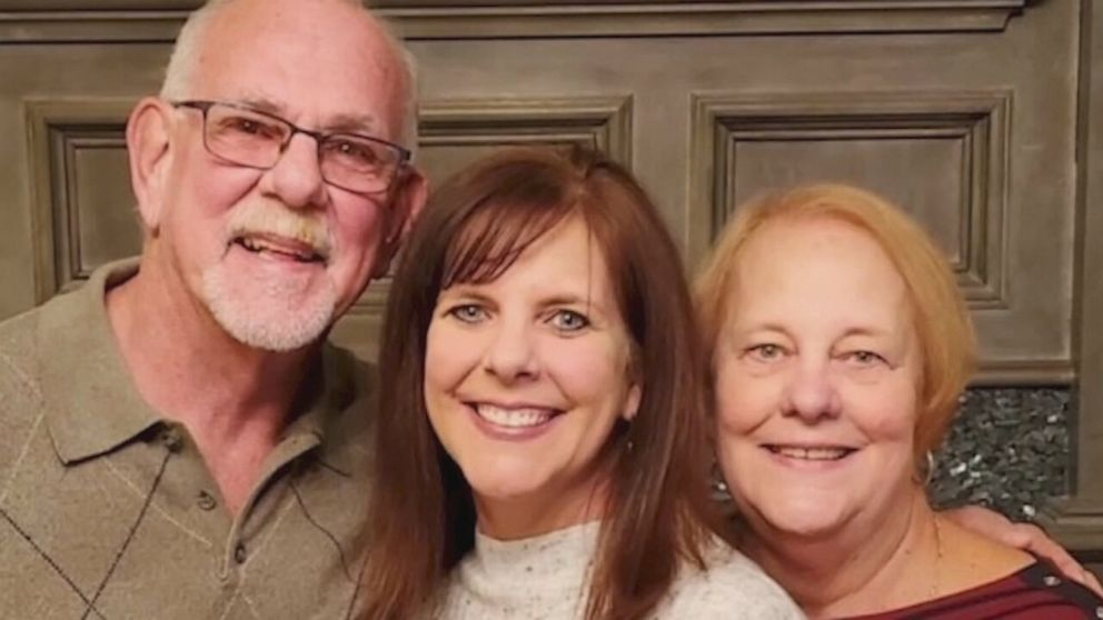 Adopted woman reunites biological parents after 50 years