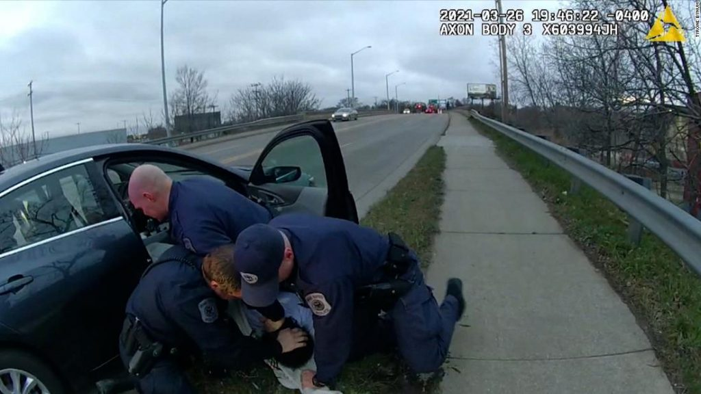Grand Rapids, Michigan police officer punches suspect during traffic stop arrest. Department chief defends actions