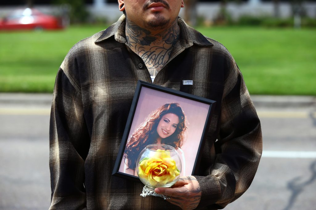 Gus Salazar holds a photo of Selena Quintanilla-Pérez on Tuesday, March 31, 2015, in Corpus Christi, Texas, as gathered to remember the Latin pop star on the 20th anniversary of her death. (AP Photo/Corpus Christi Caller-Times, Gabe Hernandez)
