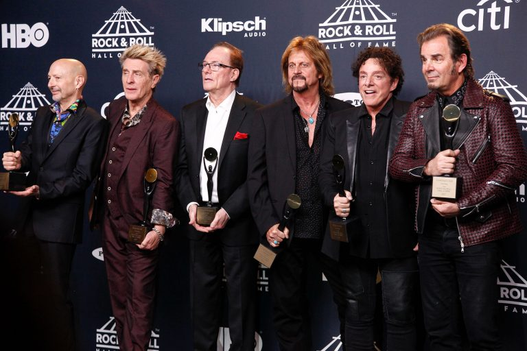 Steve Smith, from left, Ross Valory, Aynsley Dunbar, Gregg Rolie, Neal Schon and Jonathan Cain of the band Journey pose in the 2017 Rock and Roll Hall of Fame induction ceremony press room at the Barclays Center on Friday, April 7, 2017, in New York. (Photo by Andy Kropa/Invision/AP)