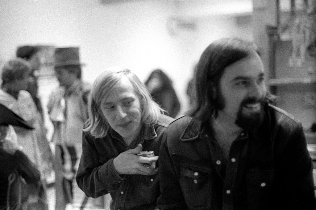 SAN FRANCISCO, CA - DECEMBER, 1970:  John Morthland and Ed Ward laugh during the Rolling Stone office Christmas party circa December, 1970 in San Francisco, California.  (Photo by Robert Altman/Michael Ochs Archives/Getty Images)