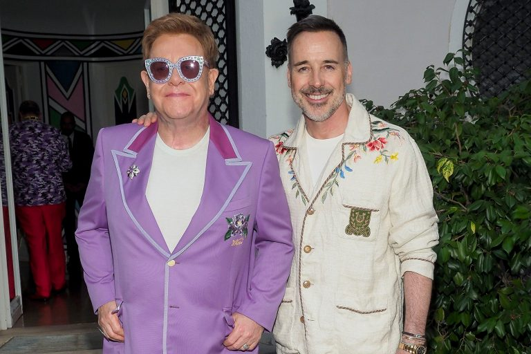 """Sir Elton John and David Furnish attend the first """"Midsummer Party"""" hosted by Elton John and David Furnish to raise funds for the Elton John Aids Foundation on July 24, 2019 in Antibes, France. (Sipa via AP Images)"""
