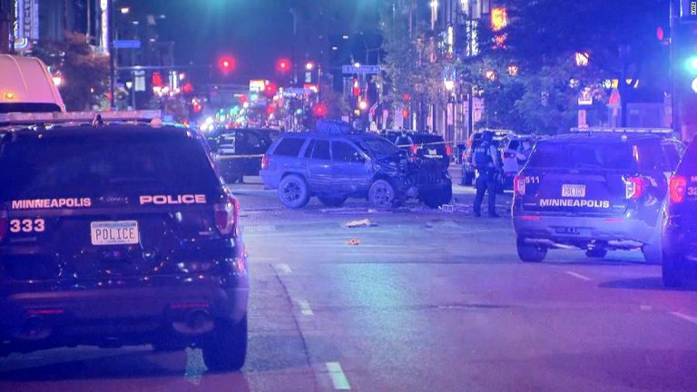 Minneapolis protests: A woman is dead after a car drove through a crowd of protesters, police say