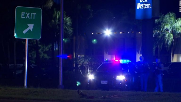 A Florida county is in lockdown as a manhunt is underway for a suspect who shot a Daytona Beach officer