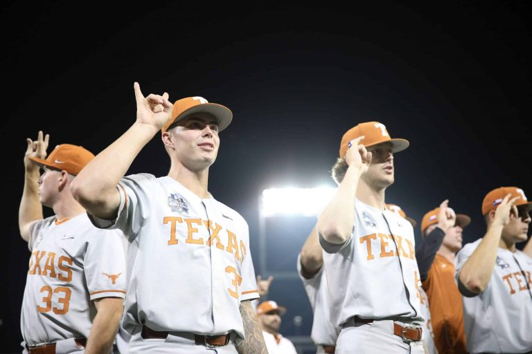 Texas downs Virginia; stays alive
