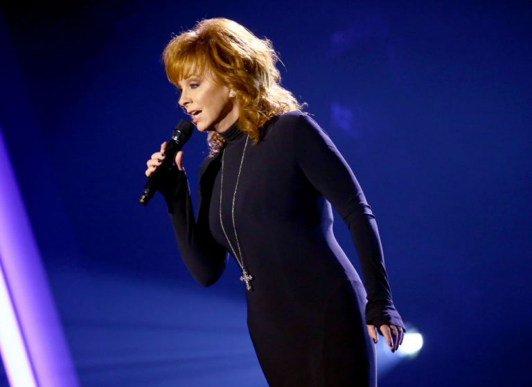 """NASHVILLE, TENNESSEE: (FOR EDITORIAL USE ONLY) Reba McEntire performs onstage at Nashville's Music City Center for """"The 54th Annual CMA Awards"""" broadcast on Wednesday, November 11, 2020 in Nashville, Tennessee.  (Photo by Terry Wyatt/Getty Images for CMA)"""