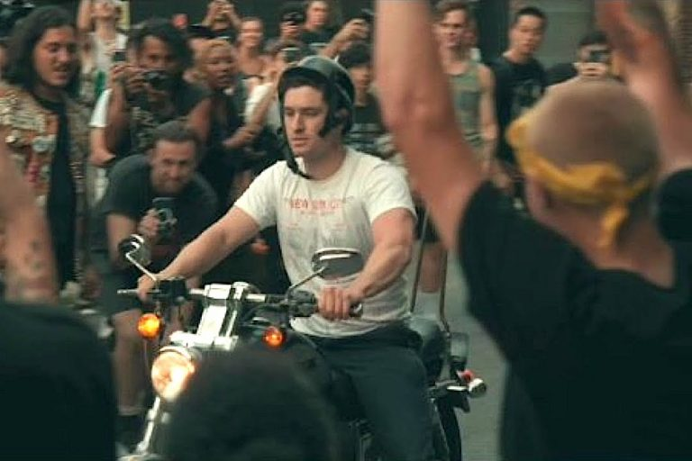 Concertgoer on Motorcycle Cruises Into Mosh Pit at Punk Show