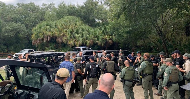 This photo provided by North Port Police Department, law enforcement officials conduct a search of the vast Carlton Reserve in the Sarasota, Fla., area for Brian Laundrie on Saturday, Sept. 18, 2021.