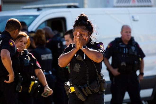 A Harris County Pct. 4 deputy exits the Harris County Institute of Forensic Sciences mourning the death of a deputy who was shot and killed in north Houston, Saturday, Oct. 16, 2021.