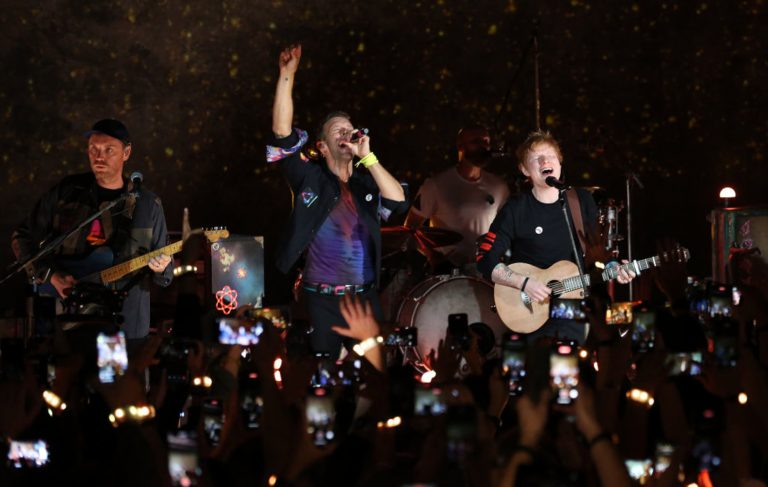 Watch Ed Sheeran join Coldplay for performance of 'Fix You' at album launch gig