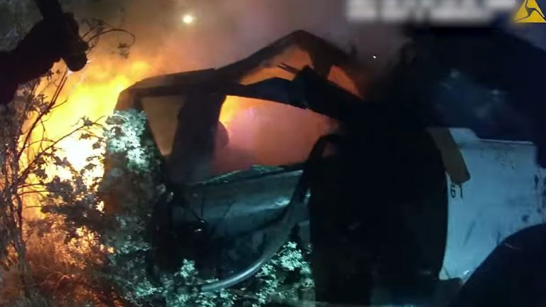 Texas police rescue unconscious driver from burning car 'with only seconds left': authorities
